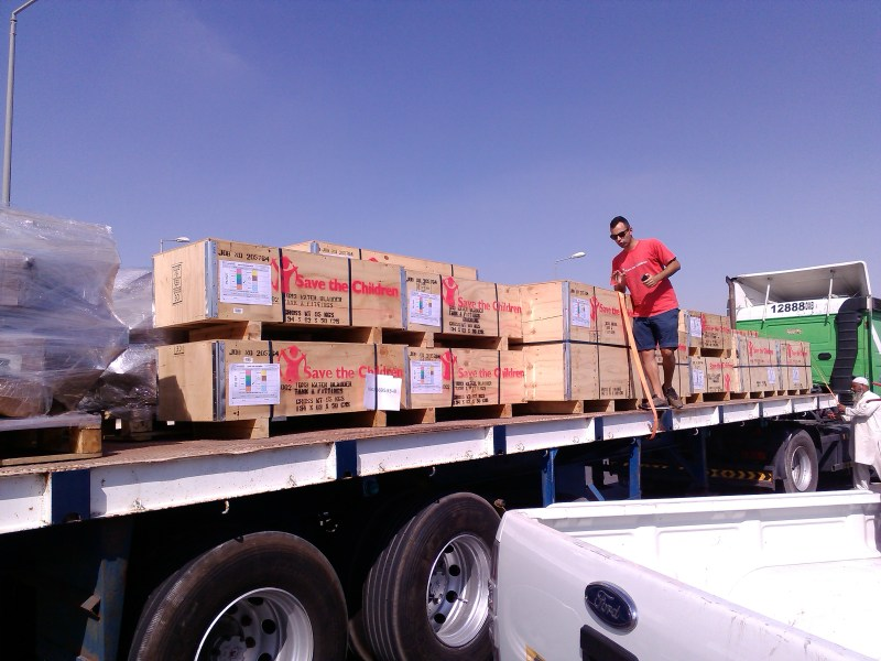 Loading aid off the plane and on to trucks for distribution. Photo credit: Save the Children