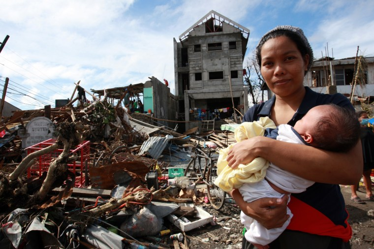 On 12 November, a woman cradling a baby stands amid debris and other destruction caused by Super Typhoon Haiyan, in Tacloban City – the area worst affected by the disaster – on the central island of Leyte. Water, sanitation and hygiene, food, medicine, shelter, debris clearance and communications are among the priority needs. Blocked roads have limited access and  the delivery of relief supplies. On 12 November 2013 in the Philippines, Government-led emergency relief and recovery operations continue in the wake of the destruction caused by Super Typhoon Haiyan (known locally as Yolanda), which hit the central Philippines on 8 November. At least 2,500 people have been killed in the Category-5 storm; the death toll is expected to rise as more affected areas become accessible. Some 11.3 million people, including an estimated 4.7 million children, in nine regions across the country have been affected, and more than 673,000 people have been displaced. Most of them are sheltering in overcrowded evacuation centres. The storm, one of the most powerful ever recorded in the world, also destroyed homes, schools, hospitals, roads, communications and other basic infrastructure, and damaged power and water supply systems. As a result, access to the many areas remains limited, hampering humanitarian relief operations. In response to the emergency, UNICEF is rushing critical supplies to affected areas, including therapeutic food for children, health kits, and water and hygiene kits for up to 3,000 families. UNICEF is also airlifting US $1.3 million in additional relief supplies from its supply warehouse in Copenhagen for another 10,000 families, including those affected by the 7.2-magnitude earthquake that hit Bohol Province in mid-October. The shipments contain water purification tablets, soap, medical kits, tarpaulin sheets and micronutrient supplements. UNICEF is also supporting water and sanitation, education and child protection interventions for vulnerable children and famili
