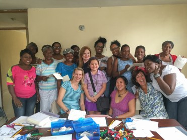 Our group of bloggers and the ladies of OFEDA, Haiti earthquake survivors.