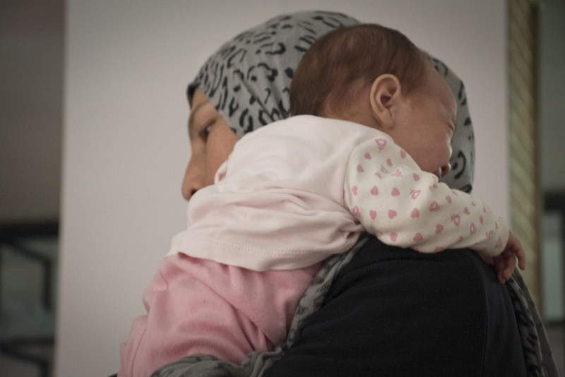 Aamal* and her baby girl Aadab* at the Asylum Information Centre in Belgrade, where Save the Children runs the Mother and Baby corner. Aamal* is originally from Afghanistan but has been living in Iran. Photo Credit: Stuart Sia/Save the Children