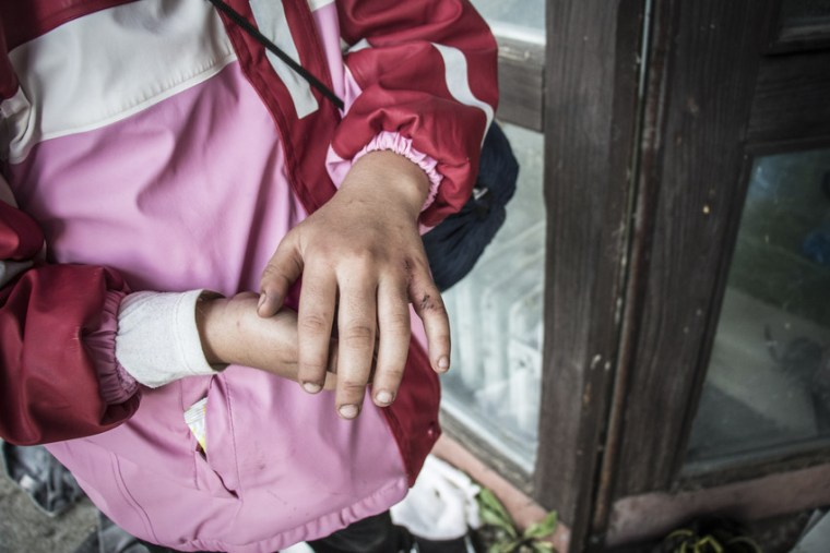 Fatima* was pushed to the ground by people running away from the police after they were teargassed, says her aunt. Her brother Karim* fell during the pandemonium caused by the tear gas and hurt his shoulder. From Syria, they are uncertain whether to stay and wait for the border to Hungary to open or to go to Sid to cross the border into Croatia. Photo credit: Stuart Sia/Save the Children