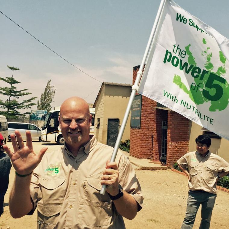 """Jeff Terry in Zambia demonstrating the """"Power of Five"""". Photo credit: Amway"""