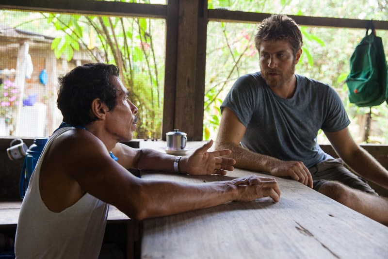 1073: Lokal Co-Founder Eytan Elterman talking with rural tourism entrepreneur Juan Cubillo in Rancho Quemado Costa Rica. Cubillo offer artisanal gold mining tours in the rainforest.