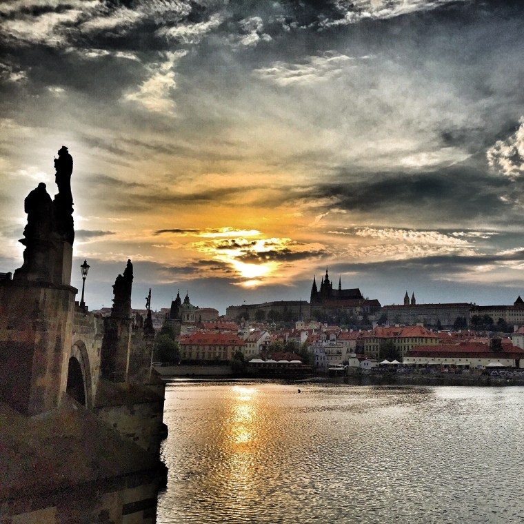 Prague at sunset on the Charles Bridge.