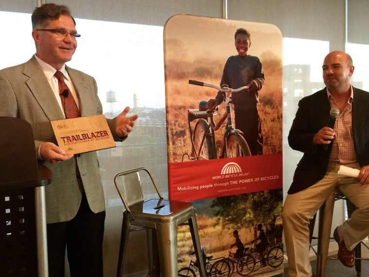 Dr. Leszek Sibilski received the Trailblazer Award presented by World Bicycle Relief. Dr. Sibilski is joined onstage by Dave Neiswander, President of World Bicycle Relief.