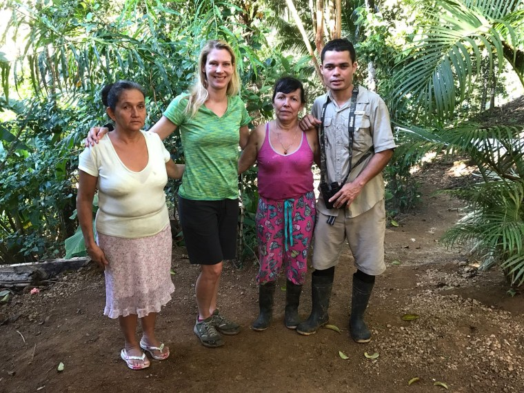 A farewell shot of Nuria, me, Xiña and our guide Toti outside of Xiña's cabin.