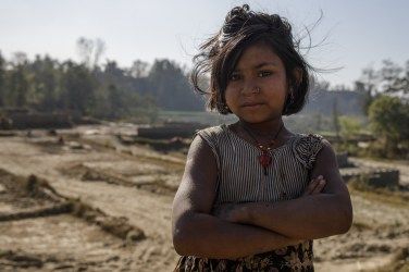One of a series of photographs taken during the DRTV shoot which took place in Nepal in December 2017. 10-year-old Sita* works in a brick kiln in the Bhaktapur district of Nepal. She's had to drop out of school in order to help support her family. And every day, she gets up at sunrise and toils until late – shaping bricks out of clay, carrying backbreaking loads and breathing dust and smoke deep into her lungs. Working in the kiln leaves Sita* exhausted and means she's missing out a vital education. That's why we're working in partnership with the Child Development Society (CDS) to stamp out child labour and protect those living and working in brick kilns. We're encouraging parents to keep their children in school, setting up daycare centres and running Child Clubs, where youngsters like Sita* can learn, play and thrive.