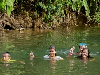There were kids taking a break from the heat and swimming in the river