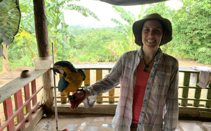 elizabeth collins holding a bird while in colombia