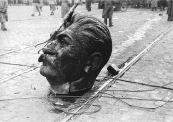 Fallen Idol: The head of the statue of Stalin laying on Grand Boulevard, Budapest