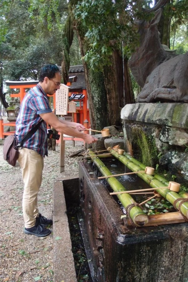 washing hands at nara park fountain
