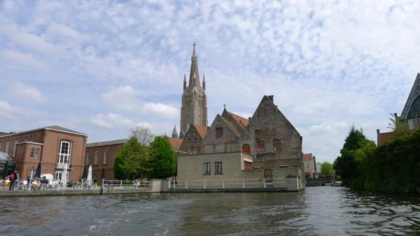 church of Our Lady from the canal, Bruges, Belgium