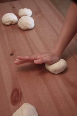 Working the dough into balls. Make sure to use a heavy hand!