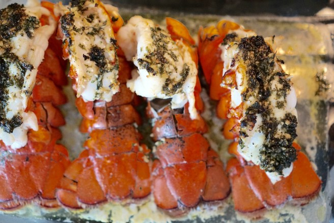 Spread over lobster tails and evenly add butter pieces to each tail.
