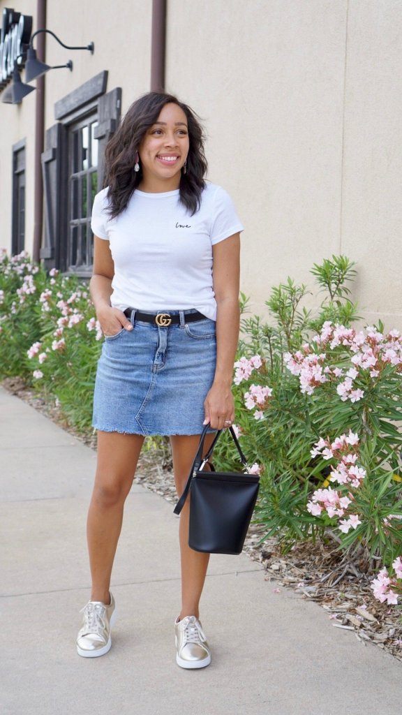 white graphic tee from H&M with denim skirt, gucci belt and metallic sneakers