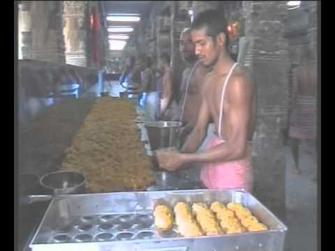 A photo of teams of priests making Tirupati laddu at Temple kitchen.