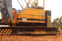 The 225 tonner, that handles concrete blocks for the upper-tier