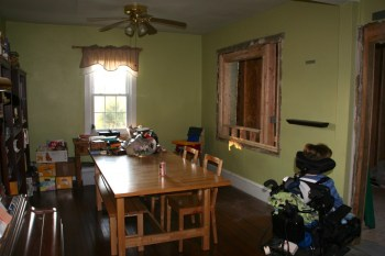Rearranged the rooms. This used to be our living room. Now the dining table is here. The opening to the right is centered over where the new sink will be.
