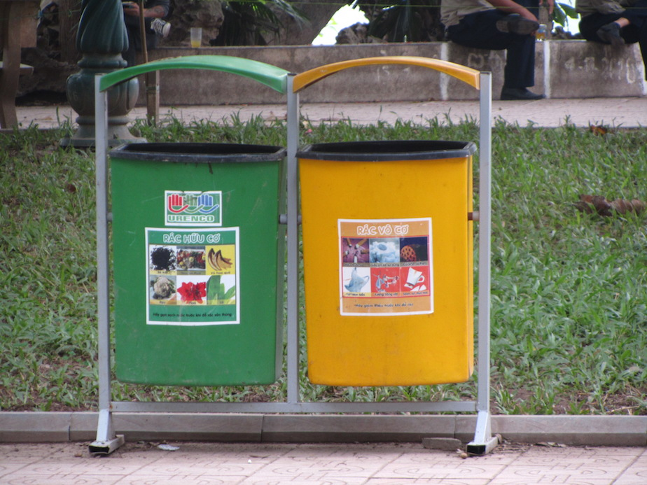 Dual compartment bins in park around Hoan Kiem Lake, Hanoi. Green, organics; Yellow, inorganics