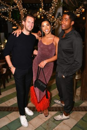MIAMI, FL - DECEMBER 06: (L-R) Brenden Fallis, Hannah Bronfman and Hassan Pierre attend Adidas Originals, British Fashion Council and David Beckham host a dinner in celebration of their creative collaboration on December 6, 2018 in Miami, United States. (Photo by Getty Images/BFC/Getty Images for BFC) *** Local Caption *** Brenden Fallis;Hannah Bronfman;Hassan Pierre