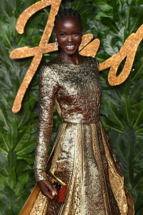 LONDON, ENGLAND - DECEMBER 10: Adut Akech arrives at The Fashion Awards 2018 In Partnership With Swarovski at Royal Albert Hall on December 10, 2018 in London, England. (Photo by Jeff Spicer/BFC/Getty Images for BFC)