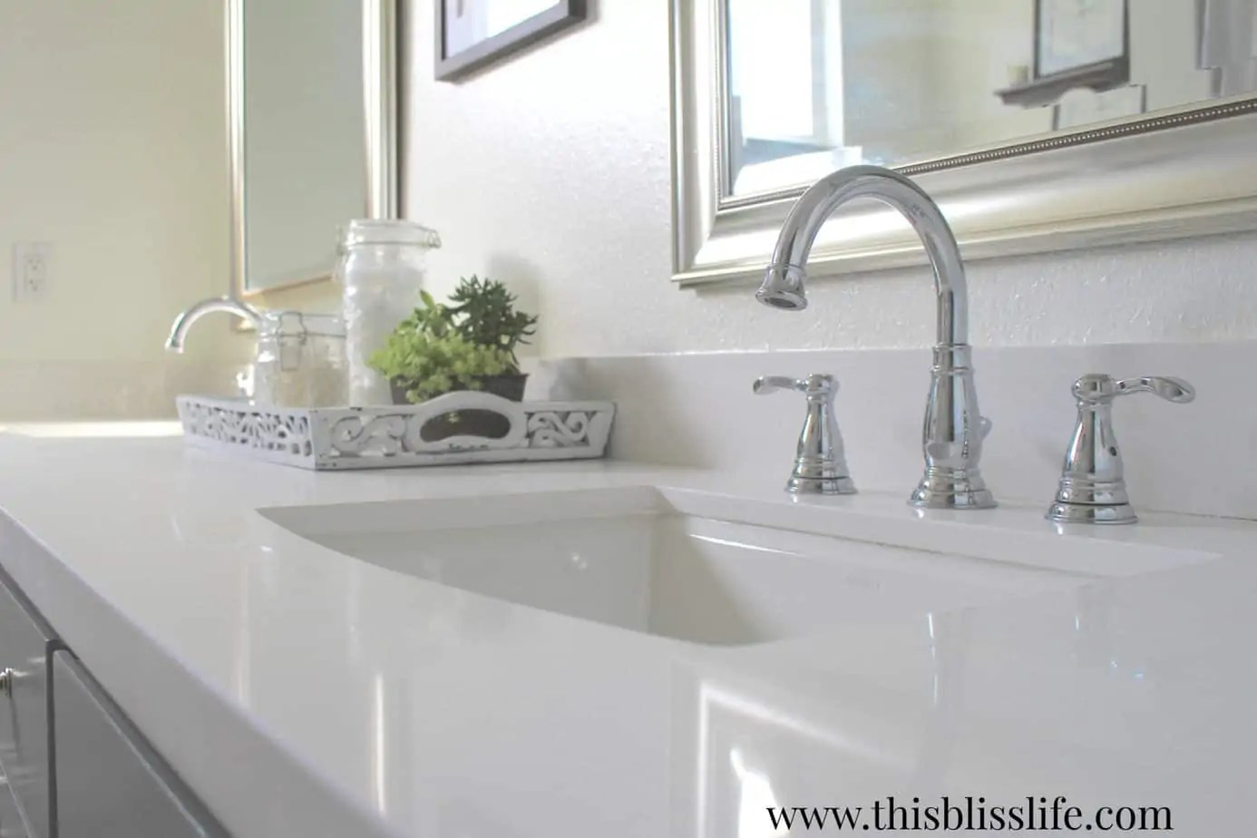 decor tips for a holiday ready guest bathroom with quilted for the countertops we went with a new white quartz and new chrome fixtures the tray is something i ve had for years and the vintage hobnail jars hold