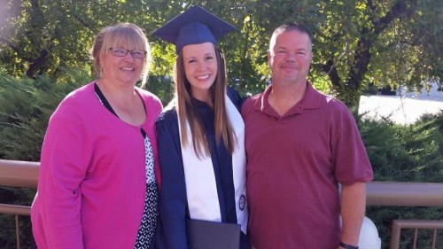 MaLee with parents at college graduation