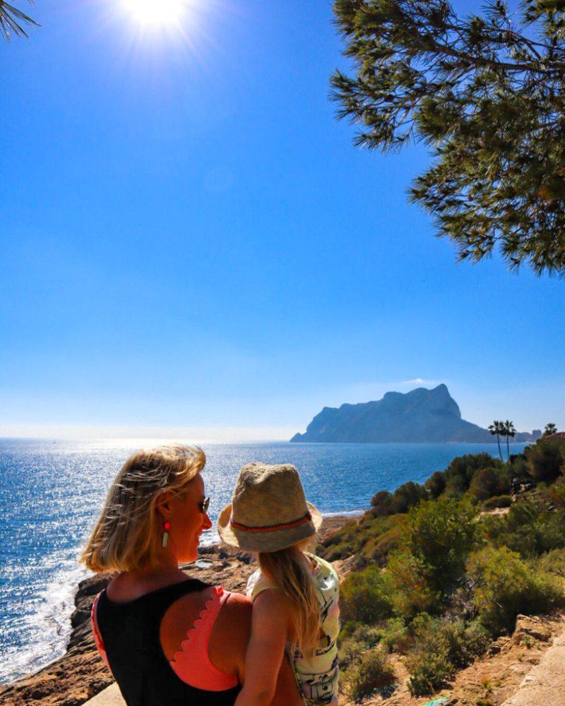 Mum and daughter looking at view of Calpe rock near Playa fustera beach