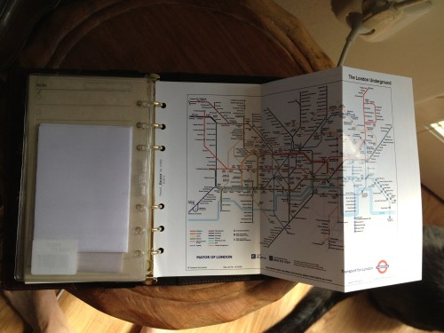 Fold out Tube map with National Rail map on reverse. Full-size booking confirmation and vouchers folded into clear pouches. Visible on left is to do list and clear index tab to separate categories closer to the time.