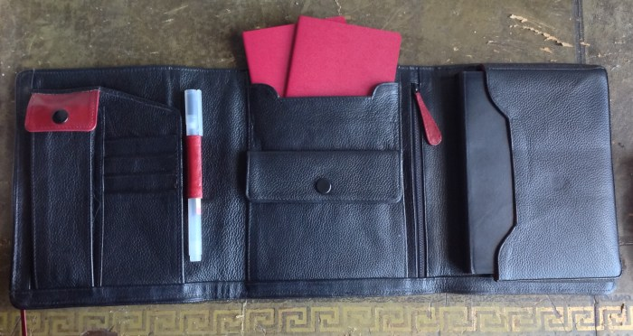 Fully stuffed - 3 spare Muji 0.38 gel pens and ruler in pen pouch, one pen in pen loop, spare Muji passport sized notebooks in middle slot. In zippered pocket I have scissors and an extra ruler. To the right is the notebook