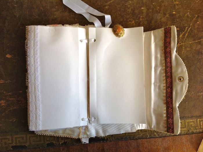 Plain pages embellished with a vintage earring