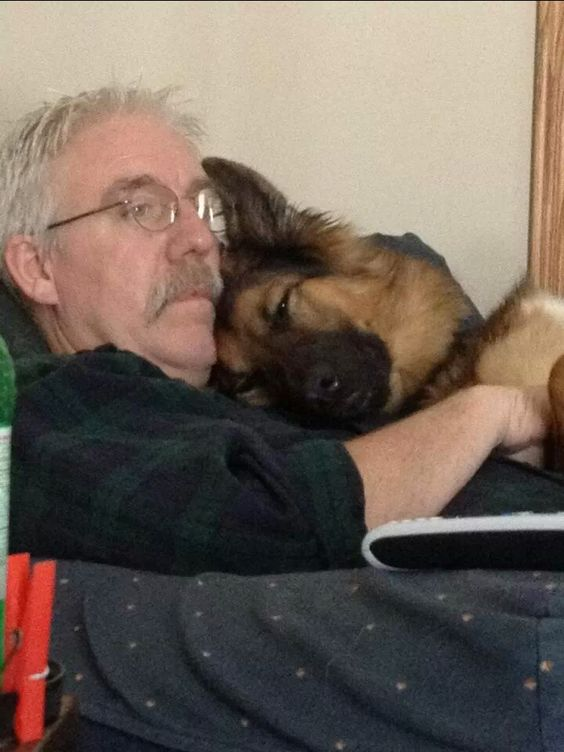 """My dad rescued her from an abandoned storefront two years ago. They watch TV like this every Sunday."""