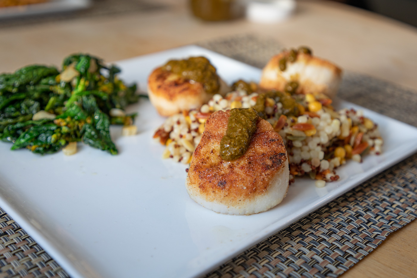 Scallops with Green Harissa, Harvest Grains, and Kale Raab