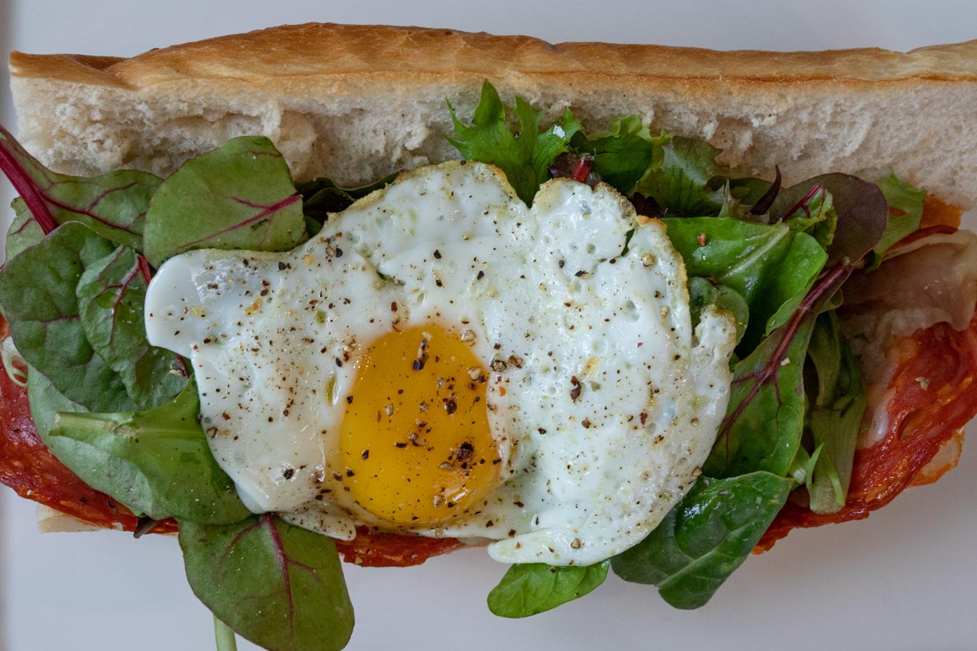 Chorizo, Manchego, Greens, and Egg Sandwich from Cafe Lutecia