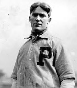 The league-leading Phils are dealt a blow when catcher-manager Red Dooin suffers a broken leg in a collision at home plate