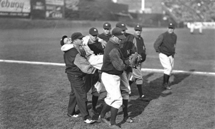 Babe Ruth of the New York Yankees collides with Charlie Berry, Boston Red Sox catcher and former pro football player, while trying to score on a sacrifice fly. Ruth is carried off the field at Fenway Park and taken to a hospital.