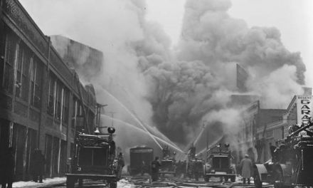 An early afternoon five-hour blaze destroys much of Fenway Park's newly-constructed concrete and steel left-field grandstand and center-field bleachers