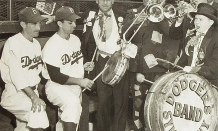 During a double-header against the Cardinals, a ragtag group of five 'musicians', dubbed the Dodger SymPhony by announcer Red Barber, makes their Ebbets Field's debut. This band, in which none of the members can read music, performs their zany antics at all evening and weekend games.