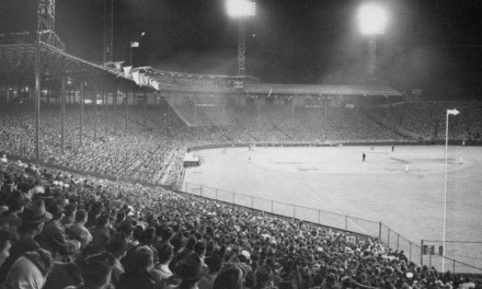 In front of the largest crowd in 13 years, theNew York Giantsdefeat theBoston Braves, 5 – 1, in the firstnight gameplayed atBraves Field. The 37,407 fans are surprised as their hometown heroes enter the field wearing shiny satinuniformsdesigned to reflect the light generated by the electricity used for the evening contest.