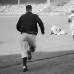 Mickey Mantle's season comes to an immediate end when he severely injures his right knee