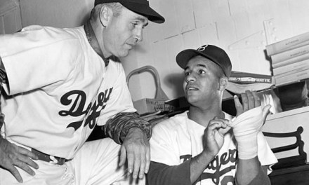 Brooklyn Dodgers catcher Roy Campanella injures his left hand in an exhibition game against the Yankees. Though he will hit two home runs on Opening Day, Campanella will have surgery in early May for the bone chips,