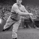 Bob Feller tops 2,500 career strikeouts and pitches Cleveland into first place