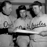 Orioles bespectacled C Clint Courtney goes 5 for 5, as Baltimore defeats the Senators, 5 - 0.
