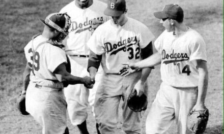 Sandy Koufax, in his second big league start, two-hits the Reds at Ebbets Field, 7-0. The 19 year-old bonus baby, displaying the dominance that he will feature during the 1960's, goes the distance, striking out 14 Cincinnati batters.