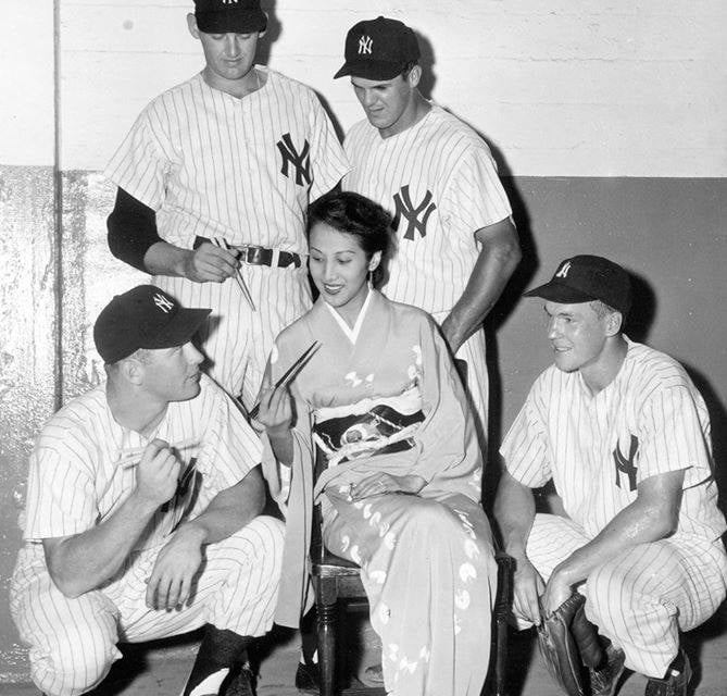 TheNew York YankeestourJapanand draw a record crowd of 64,000 when they play the first game against the All-Japan Stars inOsaka.Andy Careyslugs 13 home runs, andElston Howardbats .468 on the 25-game tour.