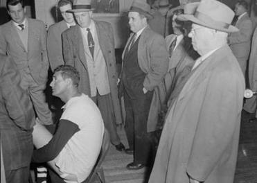 "A Boston newspaper claims that Ted Williams never paid his $5,000 fine for spitting at the crowd. It refers to him mockingly as the ""Splendid Spitter."""