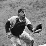 Yogi Berra commits an error as his errorless streak of 148 games for a catcher comes to an end in a New York 7 - 6 loss to Cleveland