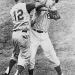 """Believing thatChicago'sJim Breweris throwing at him,Reds2BBilly Martinthrows hisbattoward the mound. Then, he advances to retrieve it from Brewer, who has picked it up. The two exchange words and Martin launches a hard overhand right that fractures the orbital bone of Brewer's right eye. Both benches empty and Martin continues swinging, deckingFrank Thomas. Brewer requires surgery and will be out of action for a month. The Cubs win, 5 - 3, onErnie Banks' homer. Martin will be fined $500 for the punch and Brewer and the Cubs will sue the combative infielder onAugust 22for $1,000,000. Years later, when the courts award Brewer $100,000, Martin's comment will be, """"How can they ever collect it? I haven't got that kind of money,"""""""