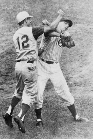 """Believing thatChicago'sJim Breweris throwing at him,Reds2BBilly Martinthrows hisbattoward the mound. Then, he advances to retrieve it from Brewer, who has picked it up. The two exchange words and Martin launches a hard overhand right that fractures the orbital bone of Brewer's right eye. Both benches empty and Martin continues swinging, deckingFrank Thomas. Brewer requires surgery and will be out of action for a month. The Cubs win, 5 – 3, onErnie Banks' homer. Martin will be fined $500 for the punch and Brewer and the Cubs will sue the combative infielder onAugust 22for $1,000,000. Years later, when the courts award Brewer $100,000, Martin's comment will be, """"How can they ever collect it? I haven't got that kind of money,"""""""