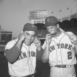 Yogi Berra slaps a harmonica from utility player Phil Linz